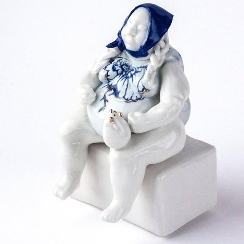 Woman in blue kerchief, Porcelian Figurine