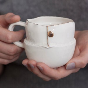 Porcelain cup with outfit