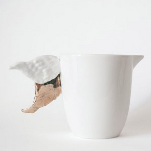Porcelain milk jug with golden wings