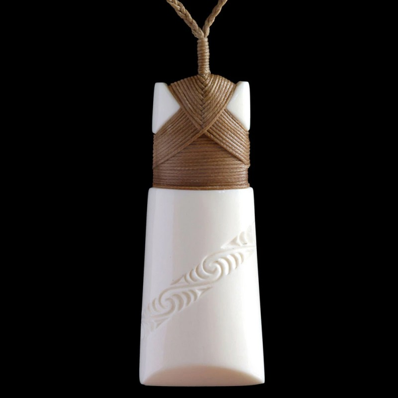 A hand crafted Toki bone carving necklace with traditional engravings